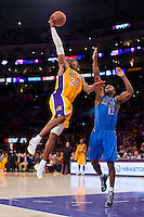 02 April 2013: Guard (24) Kobe Bryant of the Los Angeles Lakers shoots a sky hook over (13) Mike James of the Dallas Mavericks during the second half of the Lakers 101-81 victory over the Mavericks at the STAPLES Center in Los Angeles, CA.