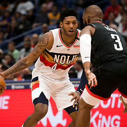Mar 24, 2019; New Orleans, LA, USA; New Orleans Pelicans guard Elfrid Payton (4) drives in against Houston Rockets guard Chris Paul (3) during the second half at the Smoothie King Center. Mandatory Credit: Derick E. Hingle-USA TODAY Sports
