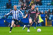 Leeds United midfielder Kalvin Phillips (23) and Sheffield Wednesday midfielder Barry Bannan (10) during the EFL Sky Bet Championship match between Sheffield Wednesday and Leeds United at Hillsborough, Sheffield, England on 26 October 2019.