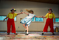 Tweedle Dee (Caitlyn Costa) and Tweedle Dum (Gabby Leclerc) have Alice (Bella Cottrell) shaken up during dress rehearsal for Alice in Wonderland with SKYT (Streetcar Kids Youth Theater) on Monday evening.  (Karen Bobotas/for the Laconia Daily Sun)