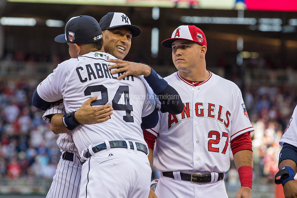 MINNEAPOLIS, MN- JULY 15: American League All-Star Miguel Cabrera #24 of the Detroit Tigers hugs Derek Jeter #2 of the New York Yankees during the 85th MLB All-Star Game at Target Field on July 15, 2014 in Minneapolis, Minnesota. (Photo by Brace Hemmelgarn) *** Local Caption *** Derek Jeter;Miguel Cabrera;Mike Trout