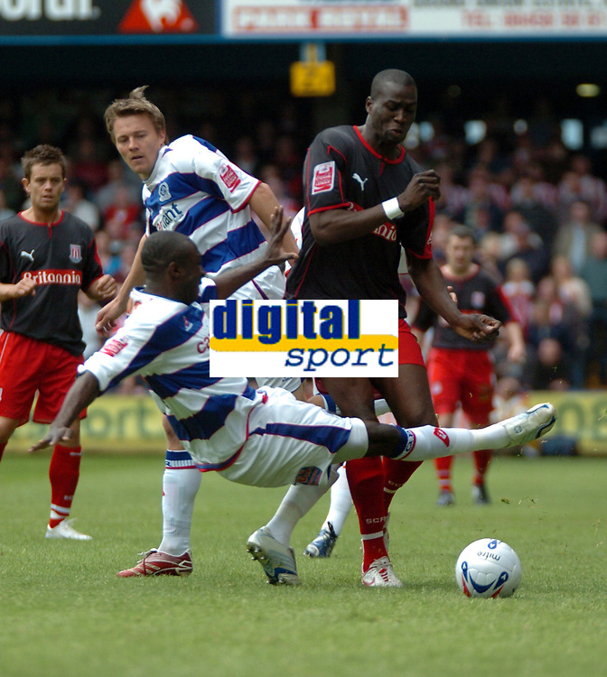 Photo: Tony Oudot.<br /> Queens Park Rangers v Stoke City. Coca Cola Championship. 06/05/2007.<br /> Mamady Sidibe of Stoke City goes past Damion Stewart of Queens Park Rangers
