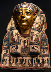 Gilded mummy mask of a man at the National Museum of Scotland in edinburgh.