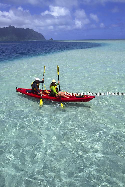Couple kayaking, Kaneohe Bay, Oahu, Hawaii<br />