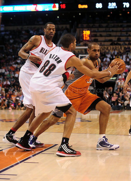 Mar. 21 2010; Phoenix, AZ, USA; Phoenix Suns forward Grant Hill (33) is guarded by Portland Trailblazers forward Marcus Camby (left) and forward Nicolas Batum (88) in the second half at the US Airways Center. The Suns defeated the Trail Blazers 93 to 87. Mandatory Credit: Jennifer Stewart-US PRESSWIRE.