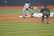 Ole Miss' Auston Bousfield (9) is safe at third vs. Rhode Island at Oxford-University Stadium in Oxford, Miss. on Friday, February 22, 2013. Ole Miss won 8-1 to improve to 5-0.