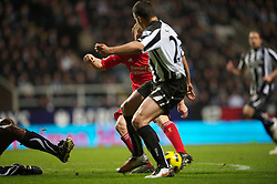 NEWCASTLE, ENGLAND - Saturday, December 11, 2010: Liverpool's Dirk Kuyt scores an equalising goal against Newcastle United during the Premiership match at St James' Park. (Photo by: David Rawcliffe/Propaganda)
