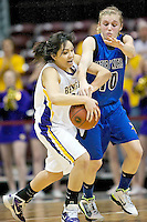 Coeur d'Alene High's Caelyn Orlandi tries to knock the ball away from Tisha Phillips from Lewiston High during the second half.