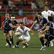 England's Greg Barden battles the Scot's 7's team for control of the ball during the 1st half of action in their game at the USA Sevens. Las Vegas, Nevada, USA.  Photo by Barry Markowitz, 2/10/12