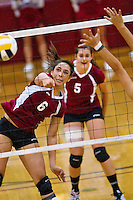 North Idaho College's Danielle Hodge watches her shot clear a weak spot in Snow College's defense to score the winning point to close the third set 27-25 during the Cardinal's sweep of the Badgers Thursday.