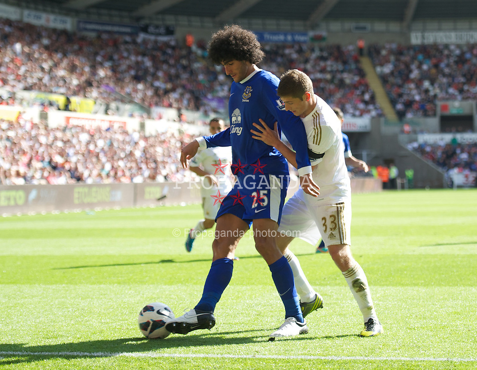 SWANSEA, WALES - Saturday, September 22, 2012: Everton's Marouane Fellaini in action against Swansea City's Ben Davies during the Premiership match at the Liberty Stadium. (Pic by David Rawcliffe/Propaganda)