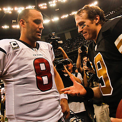 September 25, 2011; New Orleans, LA, USA; New Orleans Saints quarterback Drew Brees (9) and Houston Texans quarterback Matt Schaub (8) talk following a game at the Louisiana Superdome. The Saints defeated the Texans 40-33. Mandatory Credit: Derick E. Hingle