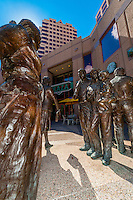 "A poured bronze public art sculpture in Albuquerque Plaza, ""Sidewalk Society"" by Glenna Goodacre, a collection of nine figures standing on a corner in Downtown Albuquerque, New Mexico USA"