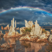 Full rainbow over tufa formations at Mono Lake, California.