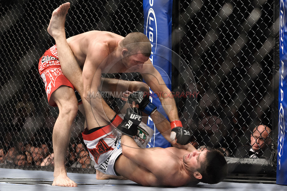 """LONDON, ENGLAND, JUNE 7, 2008: Michael Bisping (top) throws a punch to the face of Jason Day during """"UFC 85: Bedlam"""" inside the O2 Arena in Greenwich, London on June 7, 2008."""