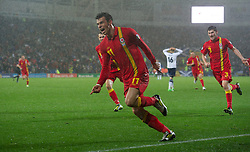 12.10.2012, Cardiff City Stadium, Cardiff, WAL, FIFA WM Qualifikation, Wales vs Schottland, im Bild Wales' two-goal hero Gareth Bale celebrates scoring the second goal against Scotland during during FIFA World Cup Qualifier Match between Wales and Scotland at the Cardiff City Stadium, Cardiff, Wales on 2012/10/12. EXPA Pictures © 2012, PhotoCredit: EXPA/ Propagandaphoto/ David Rawcliffe..***** ATTENTION - OUT OF ENG, GBR, UK *****