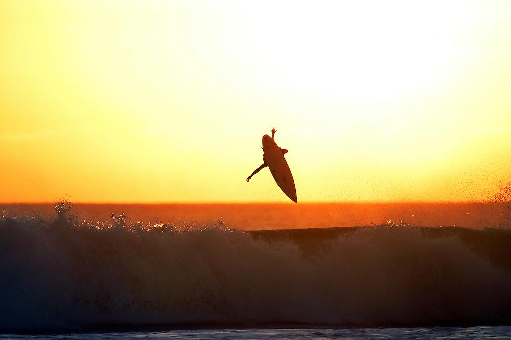 Sunset surfing aerial, Kuta Beach, Bali, Indonesia