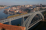 Aerial panorama of the city of Porto with the Ponte de Dom Luis I (bridge) that carries a tram service on the upper deck in the foreground. The Dom Luís I (or Luiz I) Bridge is a double-decked metal arch bridge that spans the Douro River between the cities of Porto and Vila Nova de Gaia in Portugal. At the time of construction its span of 172 m was the longest of its type in the world.