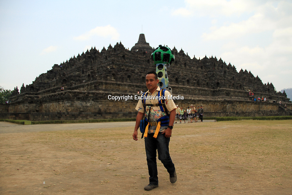 Sept. 27, 2015 - <br /> Google Maps Adds Street View of Borobudur Temple<br /> <br /> Eko Pramono, an operator holding a camera Street View Trekker down the temple of Borobudur is currently implemented by Google Maps image recording in the complex of Borobudur Tourism Park (TWCB) Magelang, Central Java, Sunday, September 27, 2015. Along with the World Tourism Day on 27 September 2015 Google marking the launch of the street view of Borobudur temple which is the majesty of the world can now be accessed through Google Maps also launched the Google Cultural Institute for Indonesia.<br /> ©Exclusivepix Media