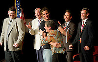 Nicholas Carey expresses his appreciation to Peggy Selig Adult Education Director as he receives his diploma on stage Friday evening along with congratulations from Robert Dassatti Laconia School Board, Robert Champlin Superintendent, Mayor Michael Seymour and Attorney General Michael Delaney.  (Karen Bobotas/for the Laconia Daily Sun)