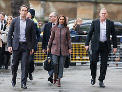 © Licensed to London News Pictures. 07/12/2016. London, UK. GINA MILLER (centre), flanked by body guards, arrives at the Supreme Court in Westminster for the third day of a Supreme Court hearing in which the British Government is appealing against the November 3 High Court ruling that Article 50 cannot be triggered without a vote in Parliament. Photo credit: Rob Pinney/LNP