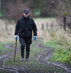© London News Pictures. 16/12/2013 . Upton, UK. Members of a police search team continue to search an area of farmland in Upton, Oxfordshire, following the disappearance of  teenager Jayden Parkinson.  Ben Blakeley today (Mon) appeared at Oxford Magistrates Court charged with the murder of 17-year-old Jayden. Photo credit : Ben Cawthra/LNP