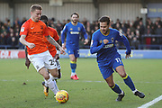 AFC Wimbledon attacker Harry Forrester (11) dribbling and taking on Southend United defender Jason Demetriou (24) during the EFL Sky Bet League 1 match between AFC Wimbledon and Southend United at the Cherry Red Records Stadium, Kingston, England on 1 January 2018. Photo by Matthew Redman.