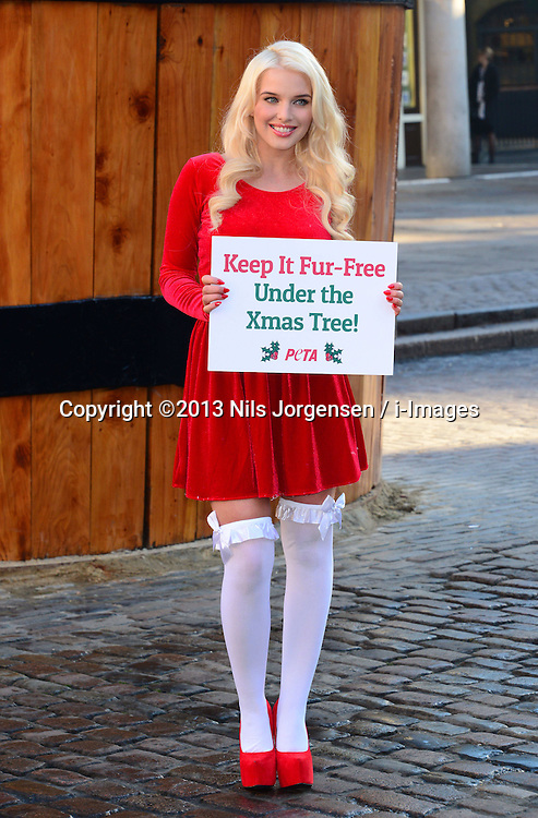 Helen Flanagan who is former Coronation Street star takes part in a photocall for PETA's, Keep It Fur-Free Under the Xmas Tree campaign, London, United Kingdom. Wednesday, 11th December 2013. Picture by Nils Jorgensen / i-Images