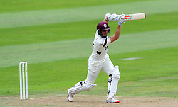 Somerset's Tom Cooper drives the ball. - Photo mandatory by-line: Harry Trump/JMP - Mobile: 07966 386802 - 21/08/15 - SPORT - CRICKET - LV County Championship Division One - Day One - Somerset v Worcestershire - The County Ground, Taunton, England.