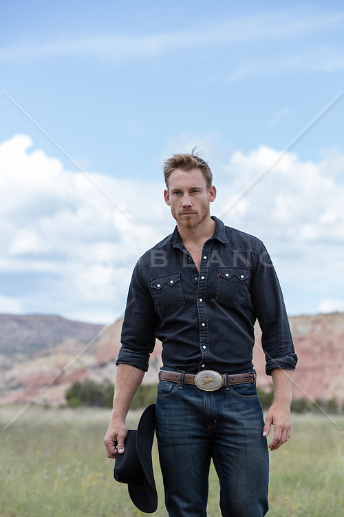 rugged cowboy walking on a ranch