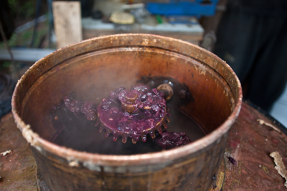 Making loza rakija (grape brandy) in Fruska Gora, Serbia. Once liquid stops coming through the copper pipe and out the other side of the still, the contents is discarded and the process begins again.