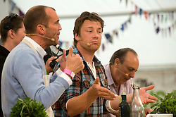 © licensed to London News Pictures. LONDON. UK.  02/07/11. Jamie Oliver giving a cooking demonstration with Johnny Vaughan and Gennaro Contaldo on day two of Jamie Olivers The Big Feastival on Clapham Common  today (02/07/2011), a three day event featuring food from some of the country's top chefs along with live music.  Photo Credit Ben Cawthra/LNP