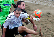 09 December 2006, South African goalkeeper Gary Johnson punches the ball away from Englands captain Jamie O'Rourke during their game at the Vodacom Pro Beach Soccer Tour in Durban's Bay of Plenty on Saturday. England won the game 3-1. Picture: Shayne Robinson, PhotoWire Africa