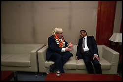London Mayor Boris Johnson waits to go on stage for a during a visit to Amity University in Uttar Pradesh near Delhi, where he addressed members of the university and took questions from Indian students, on the second day of a six-day tour of India, where he will be trying to persuade Indian businesses to invest in London, Monday November 26, 2012. Photo by Andrew Parsons / i-Images