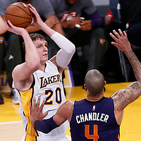 06 November 2016: Los Angeles Lakers center Timofey Mozgov (20) takes a jump shot over Phoenix Suns center Tyson Chandler (4) during the LA Lakers 119-108 victory over the Phoenix Suns, at the Staples Center, Los Angeles, California, USA.