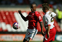 Photo: Rich Eaton. <br /> <br /> Nottingham Forest v AFC Bournemouth. Coca Cola Championship. 11/08/2007. Forest's Junior Agogo (l) shields the ball from Bournemouth's Warren Cummings (r).