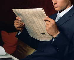 Dec. 14, 2012 - Businessman reading financial paper (Credit Image: © Image Source/ZUMAPRESS.com)