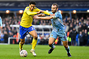 Birmingham City midfielder Jude Bellingham 22) battles for possession  with Coventry City midfielder Liam Kelly (6) during the The FA Cup match between Coventry City and Birmingham City at the Trillion Trophy Stadium, Birmingham, England on 25 January 2020.