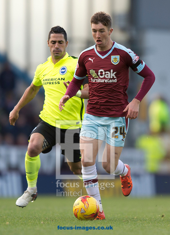 Chris Long of Burnley (right) pushes forward and is closed down by Biram Kayal of Brighton and Hove Albion during the Sky Bet Championship match at Turf Moor, Burnley<br /> Picture by Russell Hart/Focus Images Ltd 07791 688 420<br /> 22/11/2015