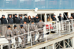 Honors are rendered as members of NH Marine Patrol carry the remains of Director David T. Barrett aboard the MS Mount Washington for a memorial service on Monday, October 23, 2011.  (Alan MacRae/for the Laconia Daily Sun)