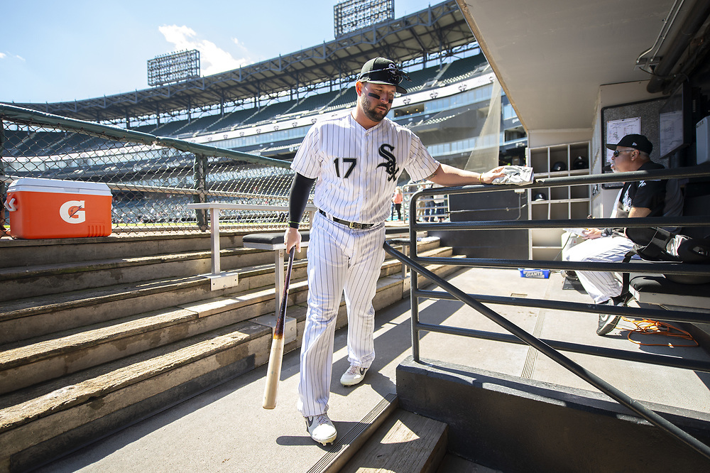 CHICAGO - APRIL 09:  Yonder Alonso #17 of the Chicago White Sox enters the dugout prior to the game against the Tampa Bay Rays on April 9, 2019 at Guaranteed Rate Field in Chicago, Illinois.  (Photo by Ron Vesely)  Subject:   Yonder Alonso