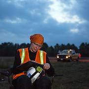 STERLING, VA - JUN13: Cythina Hauser, an Endangered Species Biologist and Project Environmental Specialist with GAI Consultants, takes field notes July 13, 2015, during a bat census, to make sure the planned Silver Line train yard near Dulles Airport doesn't impact the bats living in the woods near the site. Fine 'mist nets' are hung from polls to capture bats and determine whether there is a threatened bat species in the area. The bats are then released. (Photo by Evelyn Hockstein/For The Washington Post)