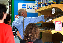 © London News Pictures. 28/07/2016. London, UK. Labour Party leader JEREMY CORBYN buying a newspaper as he returns to his London home following a ruling at the Royal Courts of Justice which upheld a decision by the NEC to guarantee Corbyn a place on the Labour Party leadership ballot.  Photo credit: Ben Cawthra/LNP