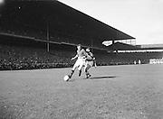 Play kicks ball during the Down v Offaly All Ireland Senior Gaelic Football Final in Croke Park on 24th September 1961.