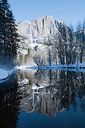 Yosemite Falls reflected in the Merced River in winter.