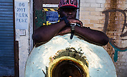 The a member of Brass Connection takes a break with his tuba after performing a set at Lumen8 in the Anacostia neighborhood of Washington DC.