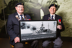 D-Day veterans Leading Stoker, Royal Navy, Fred Lee, 93 and Radar Operator Leonard Hobbs, 94 examine an enlarged Royal Mail D-Day commemorative stamp at the National Army Museum in Chelsea, London. The stamps will be released on 2nd June. London, May 22 2019.