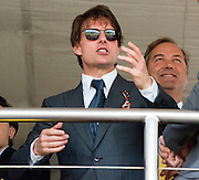© Licensed to London News Pictures. 31/07/2014. Chichester, UK Hollywood actor Tom Cruise watches the racing.  Ladies Day at Glorious Goodwood at Goodwood racecourse in Chichester today 31/07/14. Photo credit : Stephen Simpson/LNP