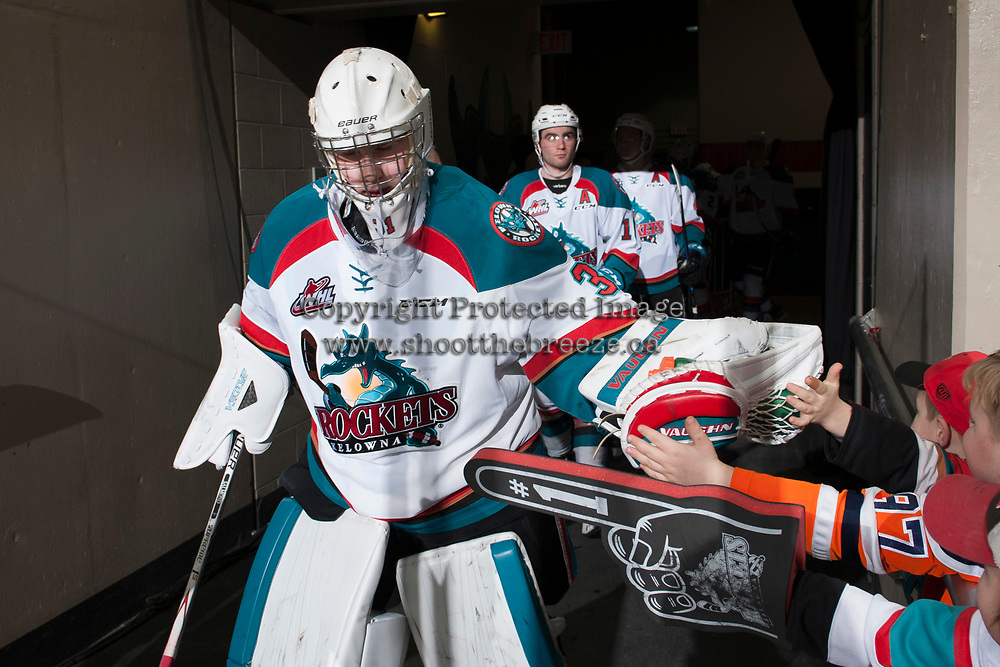 KELOWNA, CANADA - JANUARY 30: Brodan Salmond #31 of the Kelowna Rockets walks to the ice and high fives fans against the Medicine Hat Tigers on January 30, 2017 at Prospera Place in Kelowna, British Columbia, Canada.  (Photo by Marissa Baecker/Shoot the Breeze)  *** Local Caption ***