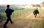 War in Kosovo<br /> KLA fighters running from house to house trying to avoid Serbian fire in the village Svrhe
